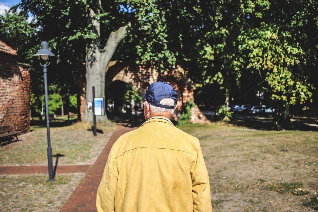 image of senior man walking in senior living community
